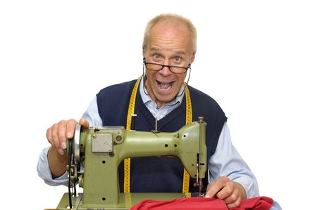 Mature tailor with a sewing  machine isolated in white Stock Photo - 6690678
