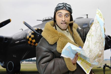 WWII figther pilot with map and funny face photo