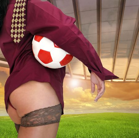 Sexy businesswomen with soccer ball photo