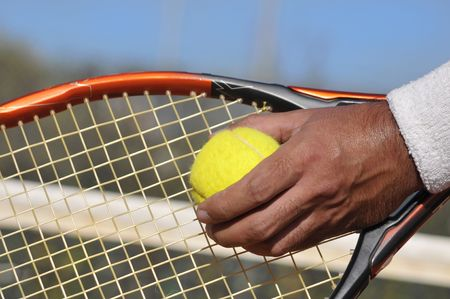 grand slam: Players hand with tennis ball preparing to serve Stock Photo
