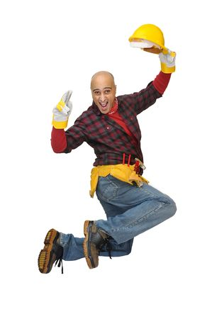 Happy construction worker jumping isolated in white Stock Photo