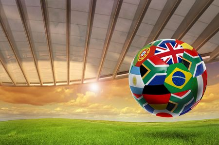 brazil country: Soccer ball with  flags in a green field Stock Photo