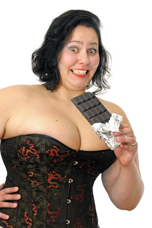 Beautiful large young woman with chocolate isolated in white Stock Photo - 6906890