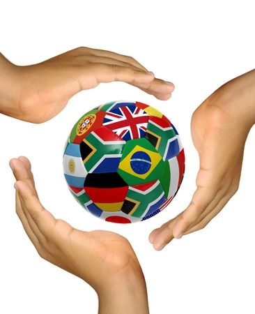 Hands making a cup over a soccer ball with flags isolated in white photo
