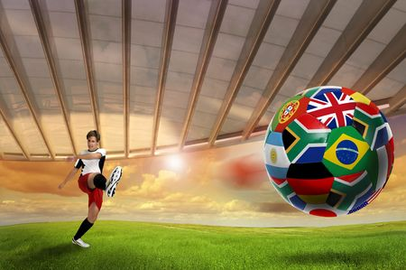 Soccer player kicking a ball with world cup nations flags photo