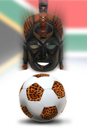 maschera tribale: Soccer ball with leopard pattern and tribal mask over South African flag Archivio Fotografico