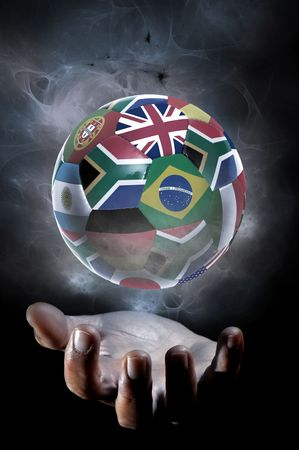 football world cup: Human hand with a soccer ball isolated in a black background Stock Photo