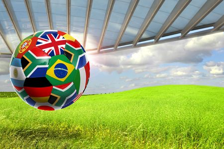 Soccer ball with  flags in a green field photo