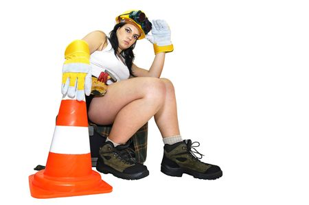 Young sexy construction worker girl isolated in white photo