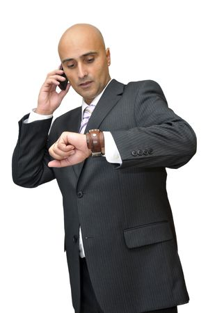 celphone: Businessman with cellphone looking at the time isolated in white