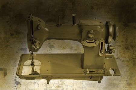 Old sewing machine isolated in a grunge background Stock Photo - 7016953
