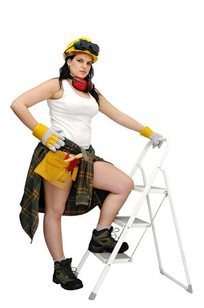 Young sexy construction worker girl with a ladder isolated in white Stock Photo - 7051422