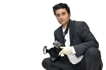 Police CSI investigator with gloves and camera Stock Photo - 7051435