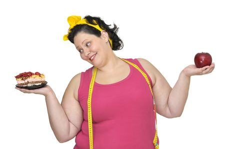 Large girl with a cake in one hand and an apple in the other photo