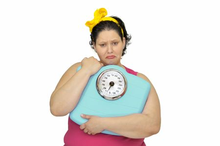 Large girl with sad face and scale isolated in white Stock Photo