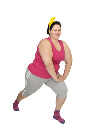 Large girl doing fitness exercises isolated in white photo