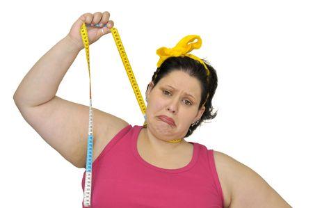 ni�a gorda: Desesperada chica grasa colgando a s� misma con cinta de medici�n