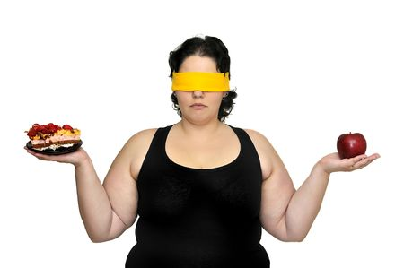 Large girl blindfolded holding a cake and an apple isolated in white photo