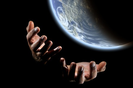hands holding earth: Human hands holding earth globe isolated in a black background