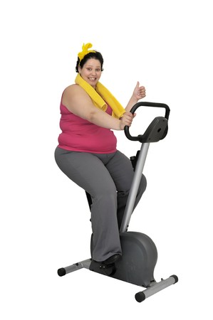 oversize: Large girl with fitness bicycle isolated in white Stock Photo