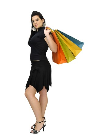 Sexy woman in black dress with colorful bags isolated in white photo