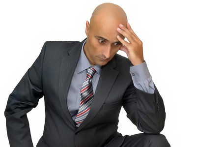worried businessman: Worried businessman isolated in white