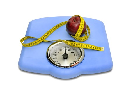Weight scale with measuring tape and apple photo