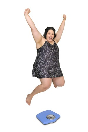 Large girl in nightie jumping over a scale isolated in white photo