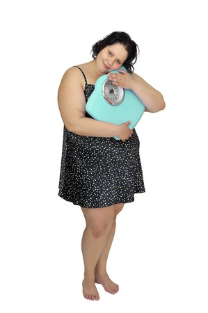 nightie: Large girl in nightie holding a scale isolated in white