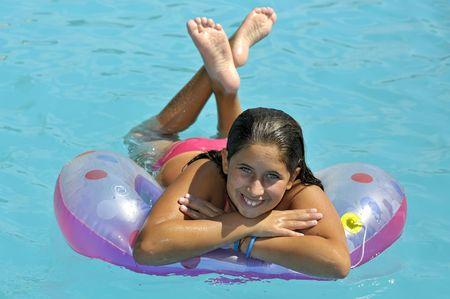 kids swimming pool: Beautiful girl posing in a swimming pool