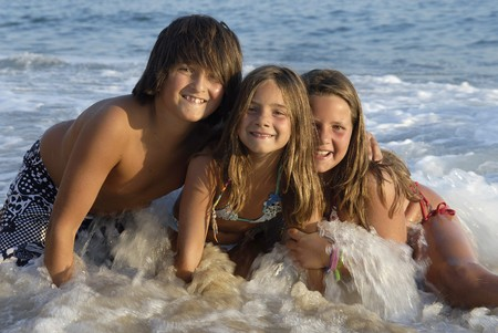Three brothers posing in the beach Stock Photo - 7794004