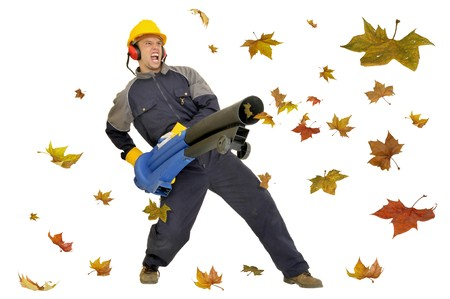 Worker with exhauster isolated in white with leaves all around Stock Photo