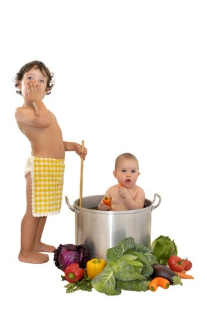 Beautiful young baby in a pan and boy cooking photo