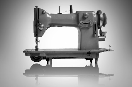 Old sewing machine isolated in a light background photo