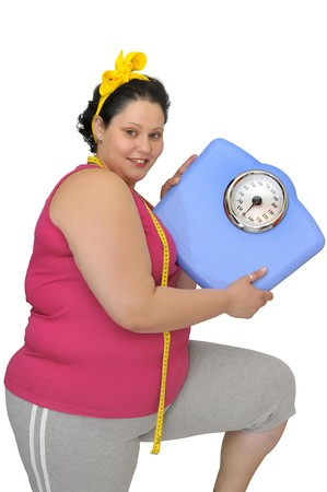Large girl with scale and measuring tape photo