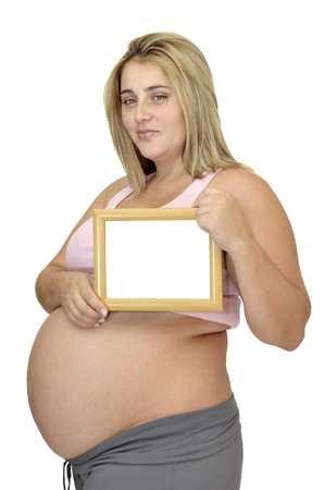 Pregnant woman holding a frame isolated in white Stock Photo - 7968919