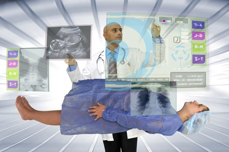 Pregnant woman and doctor with digital screen photo