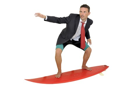 Young businessman with surf board and laptop photo