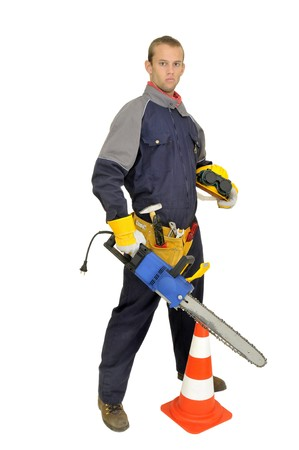 Worker posing with chainsaw isolated in white photo