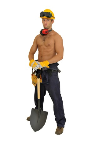 Muscular construction worker with shovel posing isolated in white photo