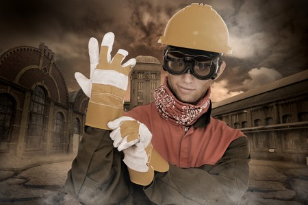 Worker posing with old factory in the background photo