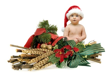Beautiful baby with Christmas decoration isolated against a white background photo