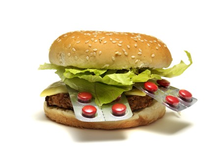 Hamburger with pills isolated in a white background photo