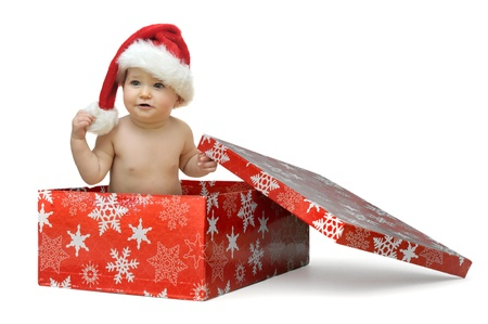 Beautiful baby with Christmas hat isolated in a gift box photo