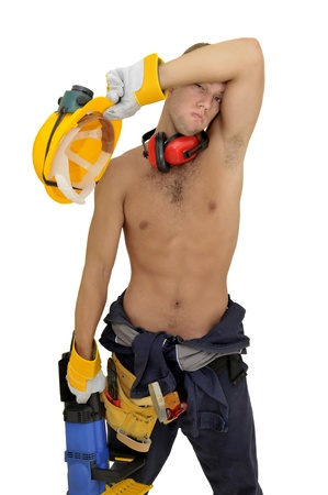 Muscular construction worker with chainsaw posing isolated in white photo