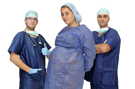 Doctors team with pregnant patience isolated in white photo