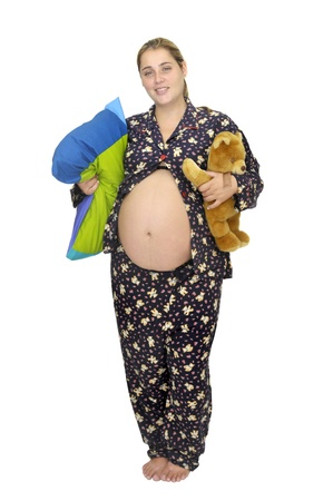 Pregnant woman in pajamas with teddy bear photo