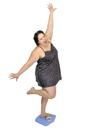 Large young woman in a scale Stock Photo - 8519427
