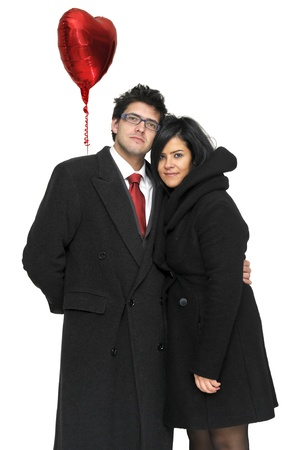 Young couple posing with red heart shapped balloon isolated in white Stock Photo - 8519511