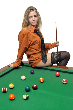 Sexy girl with mans shirt and tie posing in a snooker table photo